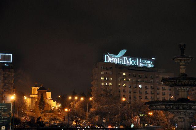 Roof DentalMed Unirea Square at Night